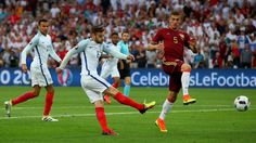 Adam Lallana's well-struck shot is palmed over the bar by Igor Akinfeev