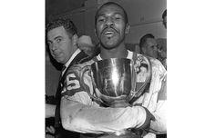 Saskatchewan Roughriders running back Ed Buchanan with the Grey Cup in the team's dressing room after the 1966 championship game win over the Ottawa Roughriders at Empire Stadium in Vancouver.