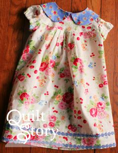 Quilt Story: Easter Dress for baby girl. Sweet Pam Kitty floral fabric and a peter pan collar.  Simplicity Pattern. Lucy is just the cutest!!