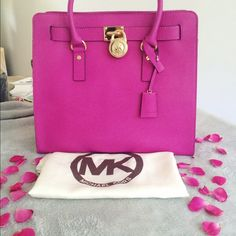 Michael Kors Large Hamilton Brand new with tags Michael Kors Large Hamilton in the color fuchsia. The bag is in perfect condition with no rips, holes, stains, or scratches on the lock. Includes lock, extension strap, dust bag, and purse fillers.                                                                        BNWT                                                              100% AUTHENTIC                                        ❌NO TRADES❌ Michael Kors Bags