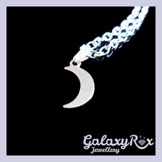 Small Silver plated Crescent moon charm pendant with a Silver plated chain.  Pendants are all one of a kind so styles and colours may vary. c4efc5b4cd5df