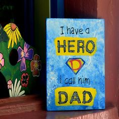 """Items similar to Hand painted-Wood Sign- Quote for Father – Wall Art """"I have a hero I call him Dad"""" Positive - Father's Gift on Etsy Home Quotes And Sayings, Family Quotes, Wooden Signs, Unique Jewelry, Handmade Gifts, Home And Family, Hand Painted, Etsy, Painting"""