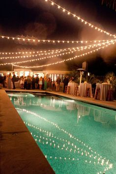 Prep your pool for a party by hanging string lights above the water.    #Contest