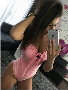 Pink lace up sleeveless ribbed body suit