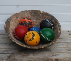 Looks great in a rec room with rustic decor. Old Croquet balls... alternate choice from 1st post.