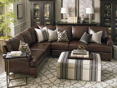 Leather Sectional and colors patterns of the room keep the space