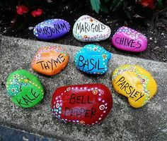 Make garden markers with stones, paint and imagination. Have fun!