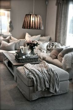 Warm grey and fuzzy, comfortable pillows and throws.