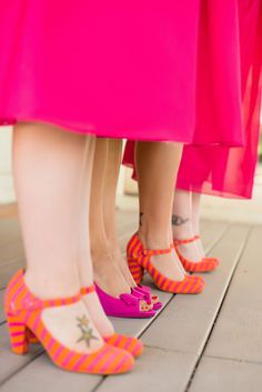 Bridesmaids in pink, with orange striped shoes!