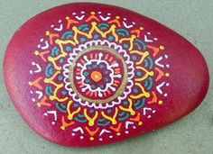 This one-of-a-kind design is hand-painted by me on river rock, using acrylic inks and paint and sealed with polyurethane to protect the design. The
