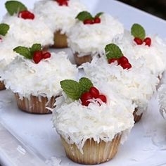 Christmas cupcakes make with coconut frosting, red hot candy for berries  mint for holly leaves