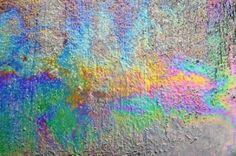 123rf.com Oil spill on asphalt road background or texture