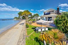 This stunning Milford beach-front home renovation was the winner of the Master Builders Gold, and Gold Reserve Awards. Gold Reserve, Beachfront House, Beach Houses, Cape Cod, Home Renovation, Architecture Design, Awards, Environment, Mansions