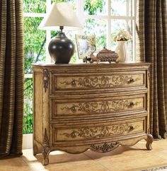 Versailles finish.    Hand applied antique rubbed finish.    Antique brass finished hardware.    Three drawers.    $974