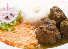 Seco de carne con frijoles y salsa criolla  Peruvian beef stew with cilanter , beans and rice