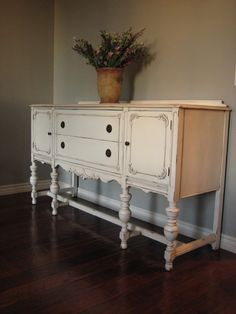 My MIL has a buffet just like this (only not white) that she is giving to me! I am going to paint it just like this and put it in the dining room...so excited!