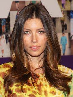 Jessica Biel with long layered waves hairstyle, bronzed skin and pink lipstick