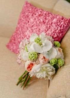 This bouquet by Out of the Garden makes us swoon! Featured in the @Jacqueline Events & Design LLC tabletop design for the Fall/Winter 2012 issue of Brides of North Texas! Photo by Celina Gomez Photography #wedding #bridal #bouquet #white #pink #green