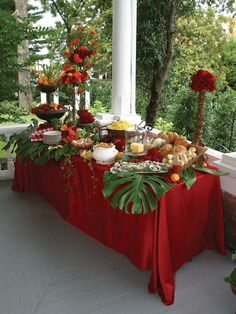 Tropical Paradise Buffet Tablescape - Can be replicated in BLUE... silk tablecloth,  tall ball on top of a candlestick,  raised roll tray, flowers and a tear drop of fruit.