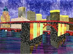 ❤ =^..^= ❤ Morrision Bridge at Night. Northwest Quilting Expo, Sept. 2014, as part of the Bridges of Portland special exhibit. Currently on display at the Portland International Airport, Concourse B, through May 2015. Designed from a photo of a painting by artist James Dunbar, with permission. I loved the way he represented the reflection of light into the water. Check out the faces fabric in the seawall.