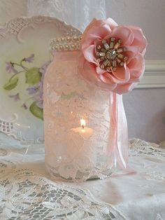 Beautiful lace and pearl mason jars for a bridal shower or wedding decor, but with a purple flower or ribbon instead....might be changing up my centerpieces