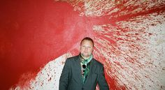 Juergen Teller infront of a painting by Hermann Nitsch. Photo: Sophie Thun