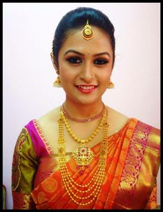 Traditional South Indian bride wearing bridal saree and jewellery. Muhurat look