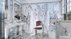 Floor to ceiling marble bathroom at the Le Meurice Hotel in Paris, France