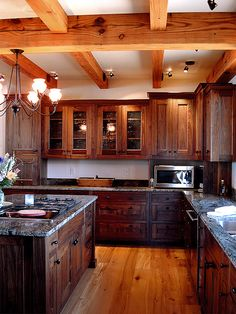 Walnut cabinets and reclaimed pine floors - so Warm.