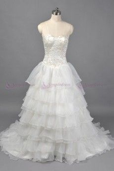 Appliqued and beaded ball gown sweetheart strapless organza over satin lace-up wedding dress