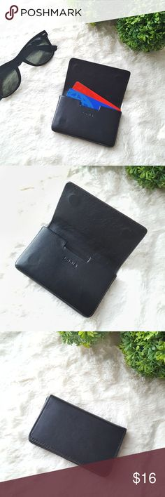 Lodis Mini Leather Card Case In excellent condition. Quite simply, chic timeless beauty, refined and elegant with magnetic closure. Features smooth grain leather, contrasting trim and interiors. Chic, unique business card case holds business cards - for the businesswoman with the heart of a fashionista. Comes from a smoke-free and pet-free home. BUNDLE for DISCOUNTS and reasonable offers are always welcome.   Measurements:  Approx 4 inches x 2.5 inches Lodis Bags Wallets