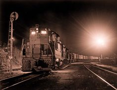 "UPDATE: One source attributes this image to Richard Steinheimer, the ""Ansel Adams of railroad photography."" ""California freight train at night, February 27, 1962."" 8x10 inch Ansco safety negative, photographer unknown. :: Shorpy Historic Picture Archive :: Night Train: 1962 high-resolution photo"