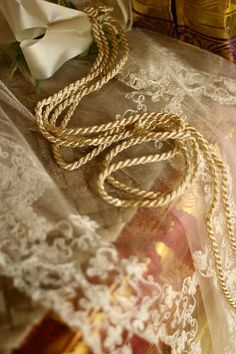 This cord is used in Filipino weddings, placed over the kneeling couple as an infinity sign.