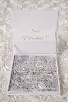 Modern beautiful white and silver acrylic boxed wedding invitation custom made with Swarovski crystals and embroidered monogram The Machados