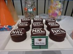 Ding Dongs as hockey pucks...love this...maybe for end of the year party since sugar is a no no during the season!