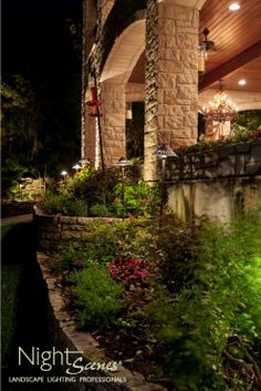 Using path lights on long stems to down light plants while up lighting the columns in Spicewood, Texas.  www.night-scenes.com