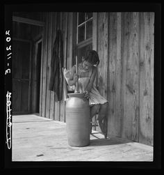 daughter of negro tenant churning butter. Randolph County, NC 1939
