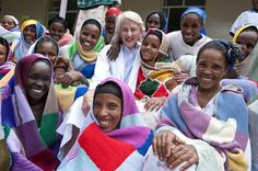 Dr Catherine Hamlin AC with her patients, all wrapped in hand knitted and crocheted creations from our wonderful supporters. See http://hamlin.org.au