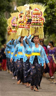 """Every pura has its own """"birthday"""" according to Balinese calendar. On every birthday, people around pura will come to pray, and bring """"sesajen"""" to devote their gods. In this picture, a group of people from one """"banjar"""" (village) dressed uniformly special for an """"odalan"""" of Pura Alas Kedaton. ❀  Bali Floating Leaf Eco-Retreat ❀ http://balifloatingleaf.com ❀"""