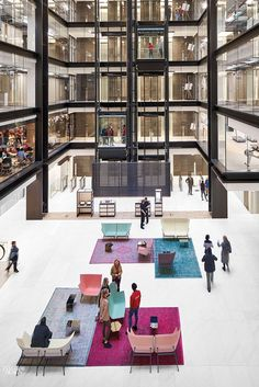 Interior Design Magazine: The glass-enclosed offices at London HQ by sit above overdyed vintage . Interior Design Magazine, Office Interior Design, Exterior Design, Corporate Interiors, Office Interiors, Architecture Office, Architecture Design, Restaurant Hotel, Atrium Design