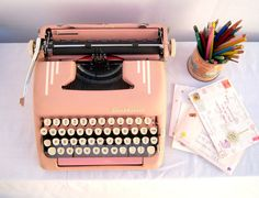 I love vintage typewriters..especially pink one's~