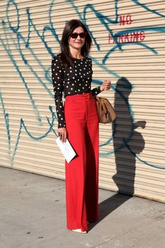 A monochrome polka dot long sleeve t-shirt and red wide leg pants are a great outfit formula to have in your arsenal. Complement this look with white leather pumps.   Shop this look on Lookastic: https://lookastic.com/women/looks/long-sleeve-t-shirt-wide-leg-pants-pumps-tote-bag-sunglasses/9548   — Black and White Polka Dot Long Sleeve T-shirt  — Brown Leather Tote Bag  — Red Wide Leg Pants  — White Leather Pumps  — Burgundy Sunglasses