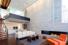 New York Triplex Showcasing an Imposing Double Height Living Zone