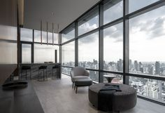 Completed in 2017 in Bangkok, Thailand. The FHM Bachelor Apartment is a stunning 3-bedroom New York inspired loft sitting on the 49th floor of the Circle Prototype, an exclusive high-rise...