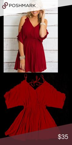 Cranberry Peek A Boo Dress The little dress is SUPER comfortable and looks GREAT on!  It has peek a boo sleeves and cinched at the top of the torso. Throw on some booties and some bracelets for the BEST LOOK!  Beautiful cranberry color and purchased at a local boutique. New with tags!! Wishlist Dresses