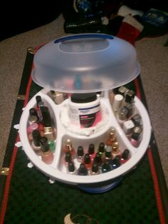 Look at this ÀWESOME nail polish caddy! Its a snack serving tray from walmart for under $6. And it holds over 50 bottles of nail polish! Easy closing handles and the nail polish remover with square cotton pieces fits right in the middle!! LOVE IT!!! Christmas gifts for all the little girls in my life for under $10. Yeah!!!!