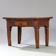 A Swedish Baroque stone top table of oak, the top inlaid with Öland stone, front with drawer. 18th century. H. 78 cm. L. 115 cm. W. 72 cm.