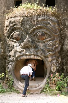 Vientiane. Laos. At the Buddha Park also known as Xieng Khuan (City of Ghosts) there are more than 200 Hindu and Buddhist statues. Through a demon´s mouth you can enter a building. Stairs bring you up (Sea Top View) Lion Sculpture, Statue, Sculpture