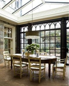 Amazing dining room/conservatory here; can you imagine the light bouncing off the chandelier in a room like that? Also the mullions on those dark charcoal windows are wonderful. Sala Tropical, Stone Interior, Interior Design, Interior Decorating, Natural Interior, Interior Modern, Orangerie Extension, Sunroom Dining, Dining Area