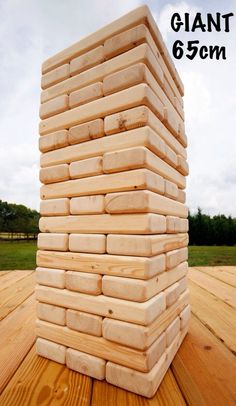 -Homemade Giant Jenga consists of 54 sanded wooden blocks -Australian Made -Height is 65cm & 21cm Wide at the beginning -Ideal game for engagement parties, weddings, community events, outdoor activities, birthdays or social gathering. -Played by all ages -Comes in a box with rules & drinking game